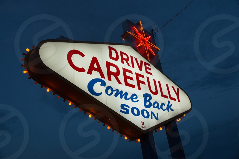 Drive Carefully Neon Sign On The Way Out Of Las Vegas photo