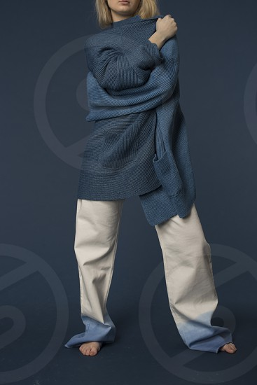 Fashion photography shoot with a focus on knitwear and denim soft lighting and studio set up. photo