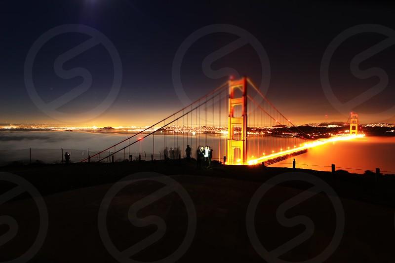 large lighted bridge at night photo