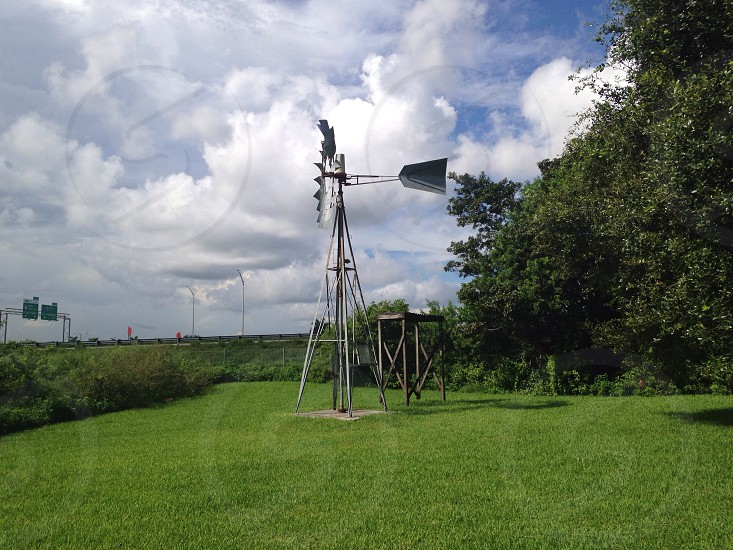white and black windmill power generator on green lawn photo