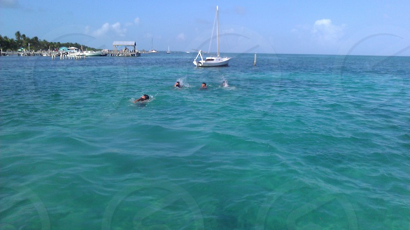Tropical Belize Caye caulker Caribbean sea swimming boat pier photo