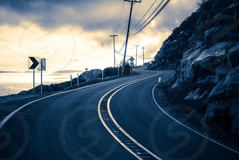 yellow lined grey concrete curved road photo