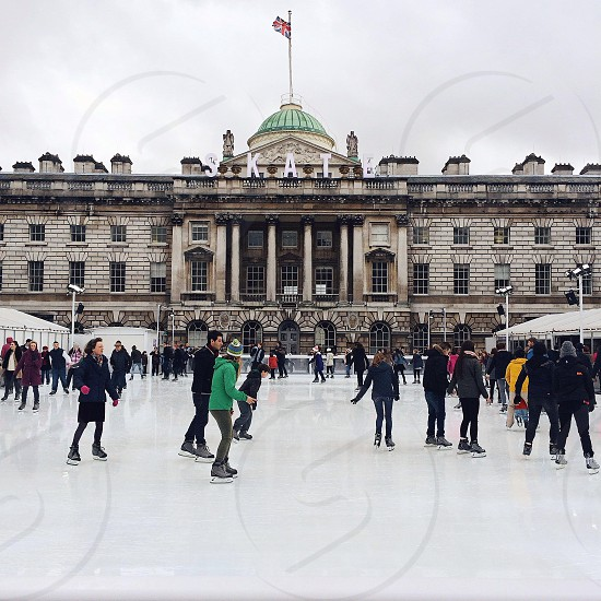 people skating on an ice rink photo