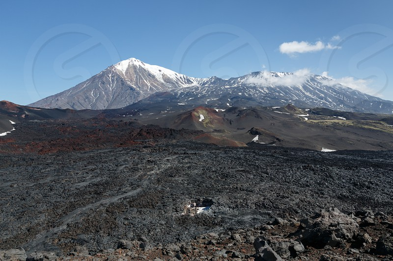 Beautiful volcanic landscape of Kamchatka Peninsula: view of Tolbachik Volcanic Massif - cone of dormant Ostry Tolbachik Volcano and cone of active Plosky Tolbachik Volcano on a clear sunny weather. Eurasia Russia Far East Kamchatka Klyuchevskaya Group of Volcanoes. photo