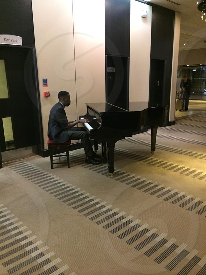 Pianist piano man playing instrument hotel lobby hilton photo