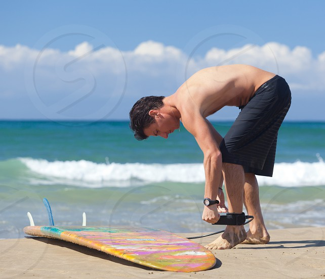 Portrait of Surfer with longboard on the beach. photo