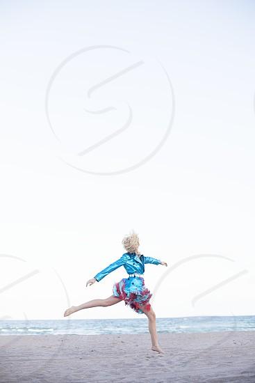 woman galloping in beach photo