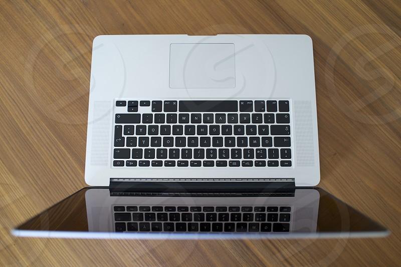 macbook on table photo