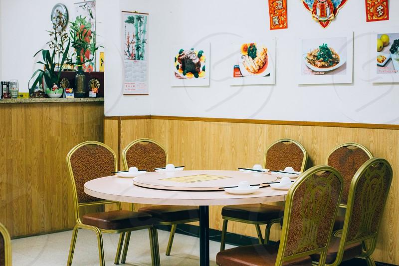 white ceramic round plates on table photo