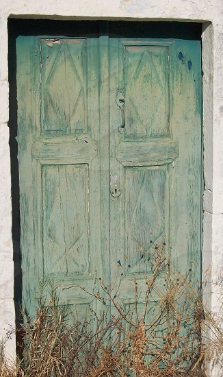 door -  Greek -  Greece -  sun beached - character -  painted - worn - weathered - faded - old -  opening - entrance - neglected - back to nature - peeling - shabby - tatty - forgotten photo