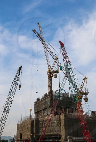 Cranes in concert building a skyscraper. Lines cables architecture construction.  photo
