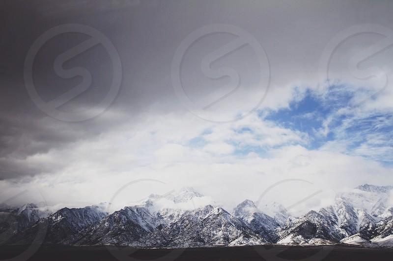 View of mountain ranges and dark skies photo