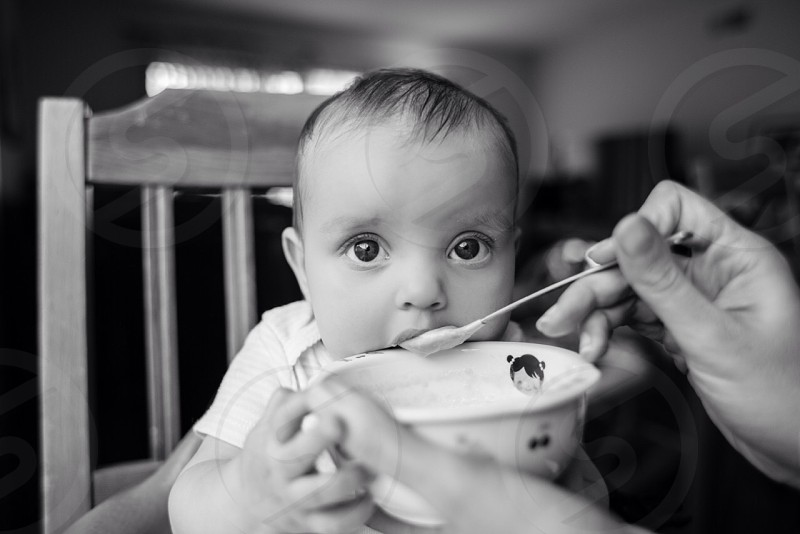 Baby eating food home daughter photo