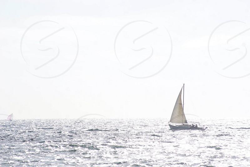 Monochrome sailboat on the ocean photo