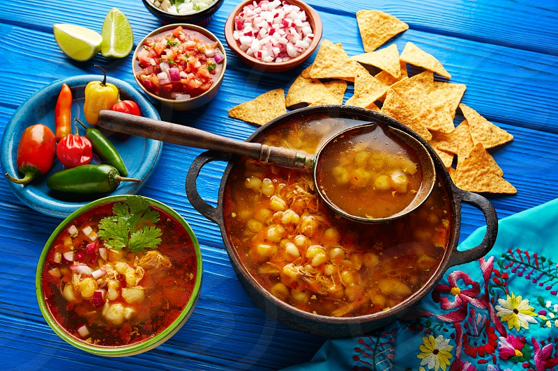 Pozole with mote big corn stew from Mexico with ingredients and appetizer photo