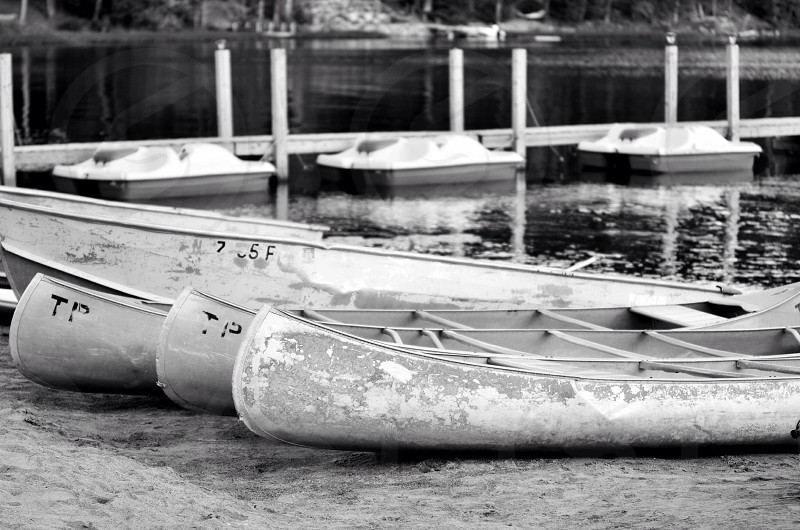 grayscale photography of canoes photo