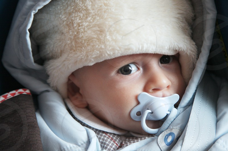 Baby going for walk in winter day photo