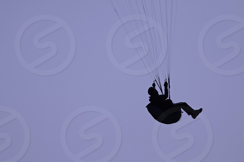 silhouette of a person with parachute photo