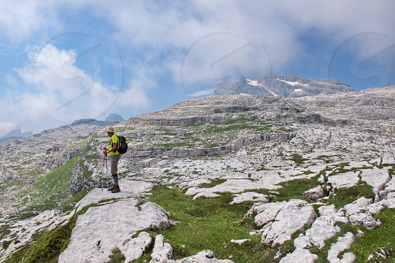 Portrait of senior hiker in Brenta Dolomites. Scenic rocky landscape photo