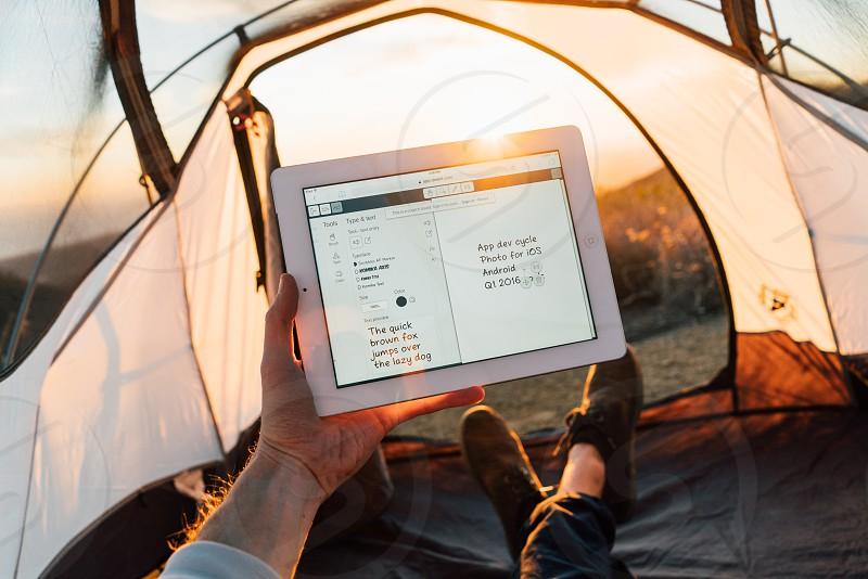 tent nature remote working work iPad tablet camping technology photo