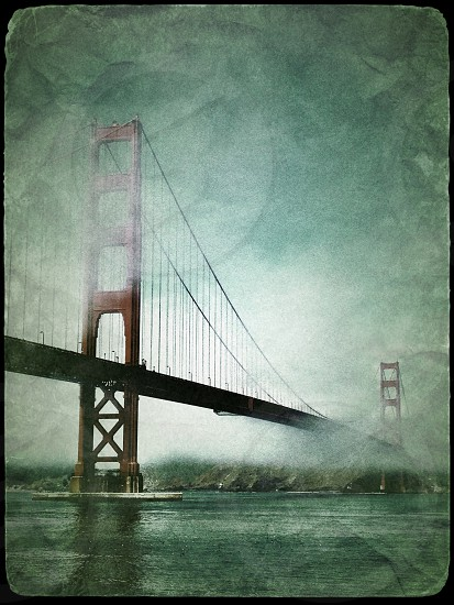 San Francisco California Golden Gate Bridge cloudy shoreline icon  photo