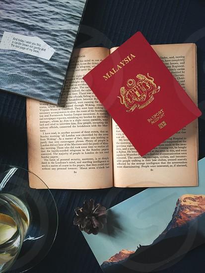 Malaysian passport wanderlust flat lay photo