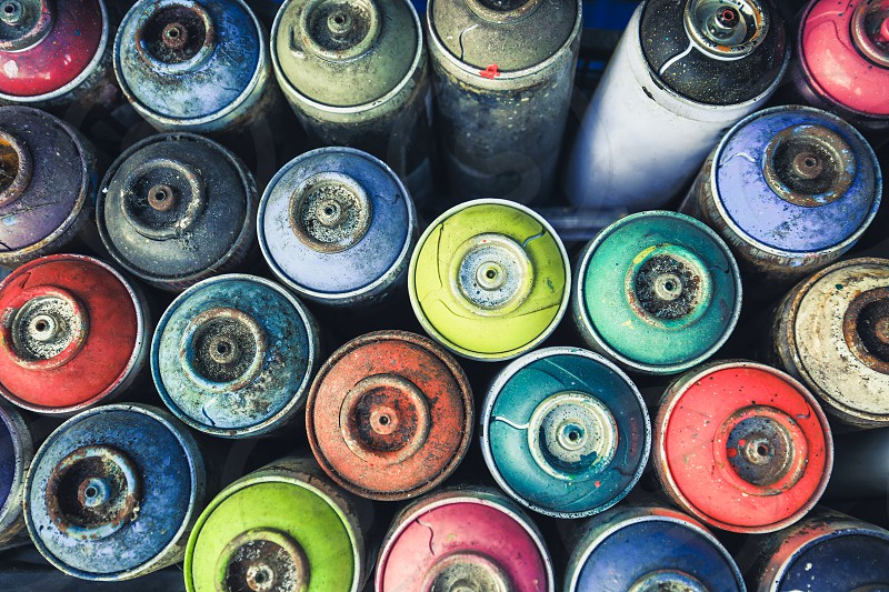 Spray cans photographed from above you see all the colors usable. photo
