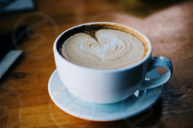 white ceramic coffee cup with white liquid photo