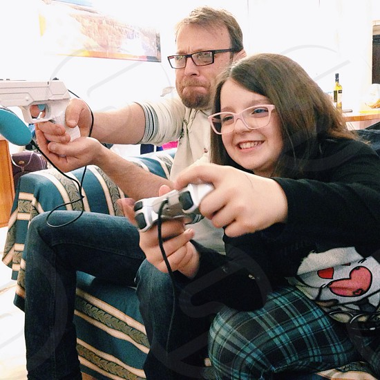 man and girl playing video games photo