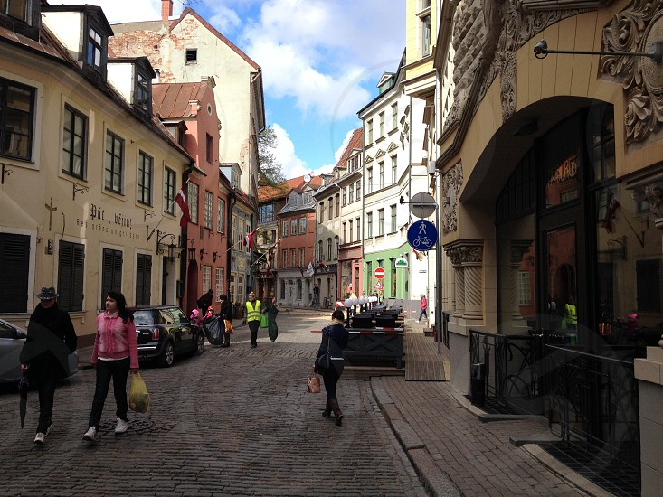 people on cobblestone street photo