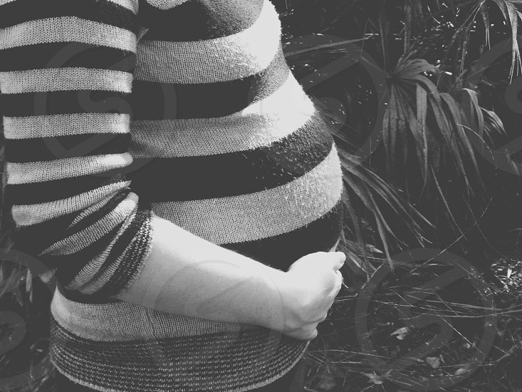woman in grey and black stripes shirt photo