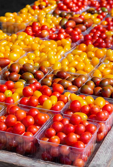 Many varieties of cherry and grape tomatoes at a local farmer's market photo