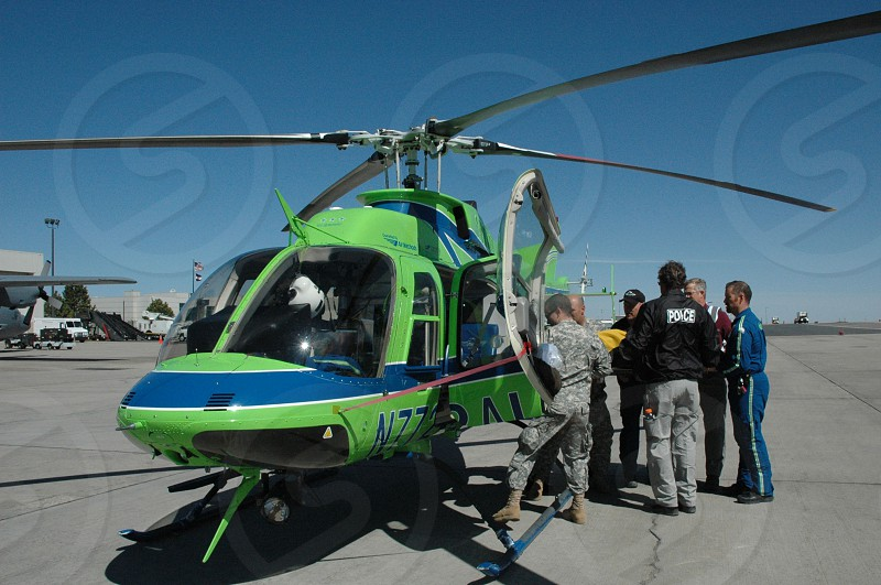 Loading patient onto medical helicopter photo