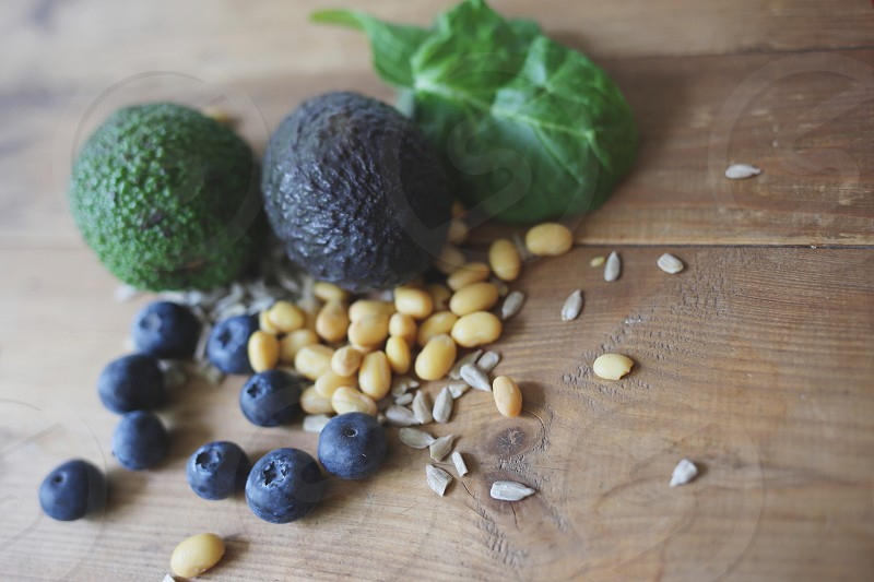 Healthy food blueberries soybeans avocado seeds sunflower seeds beans spinach baby spinach  photo