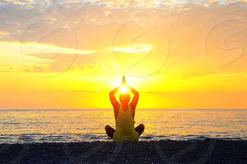 man in white tank top doing yoga photo