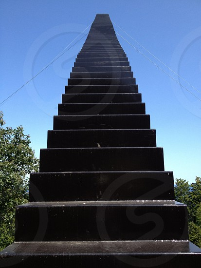gray concrete stairs in low angle photography photo