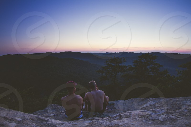2 dudes watching the sunset at red river gorge ontop of court house rock photo