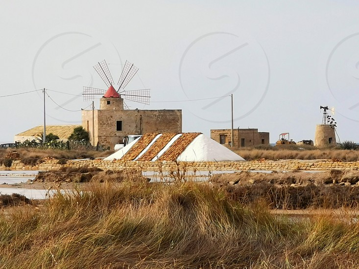 Salt pans with windmill in Sicily (Trapani) photo
