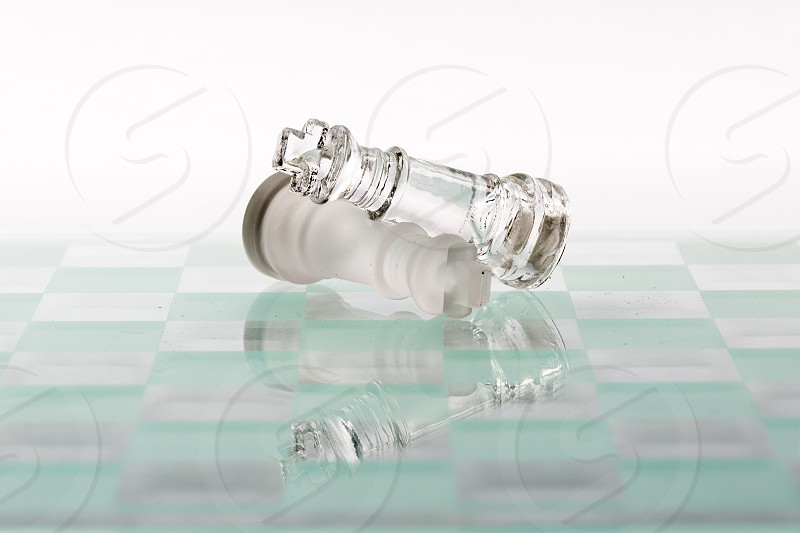 clear glass chess king piece photo
