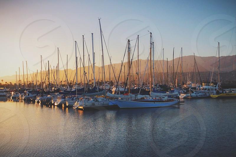 Sunset over the harbor in Santa Barbara CA photo