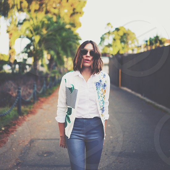 woman wearing blue pants photo