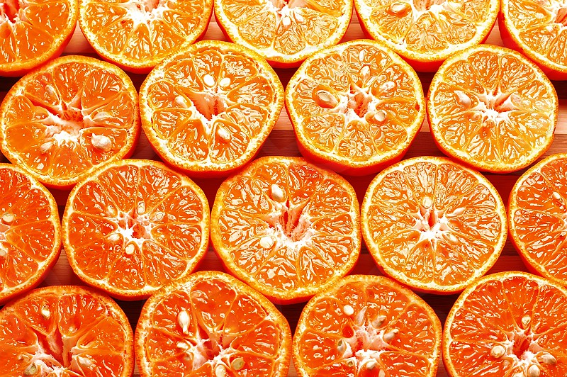 ripe orange mandarins cutted in half photo