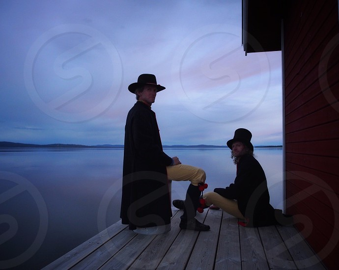 Friends midsummer Sweden brothers lake resting summer Rättviks suit hat traditional view Dalecarlia photo