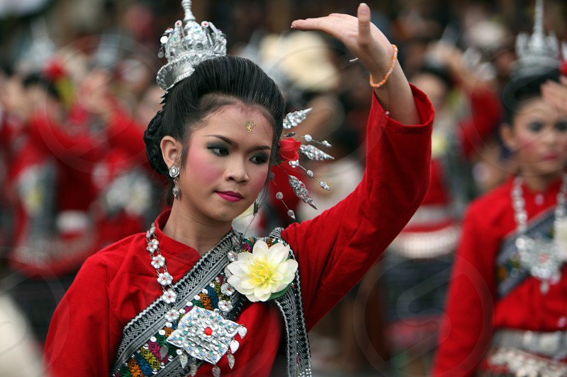 Thai Dance at the Bun Bang Fai Festival or Rocket Festival in the City of Yasothon in the Region of Isan in Northeast Thailand in Thailand. photo