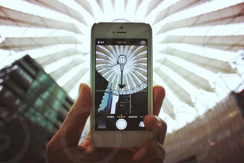 white apple iphone 5 taking a photo photo