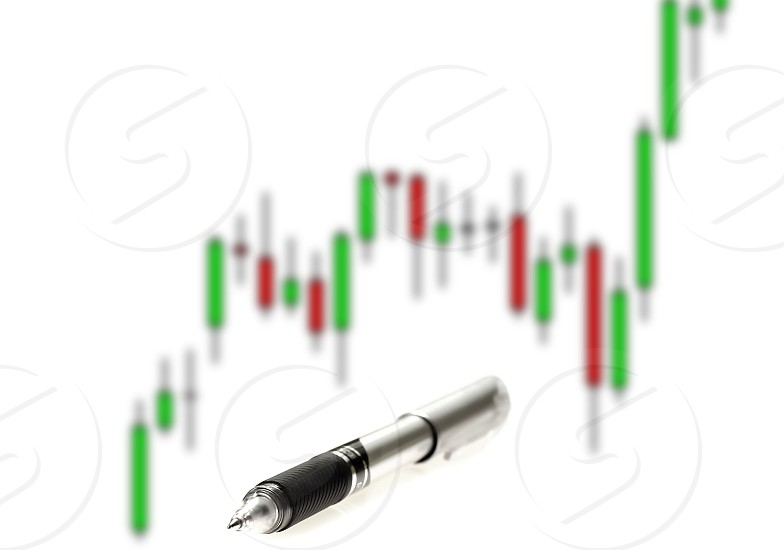 japanese candlestick chart with pen on white background photo
