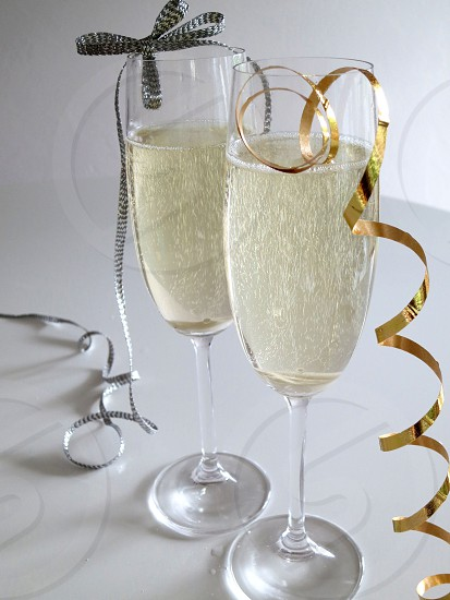 Champagne flutes ribbons gold silver photo