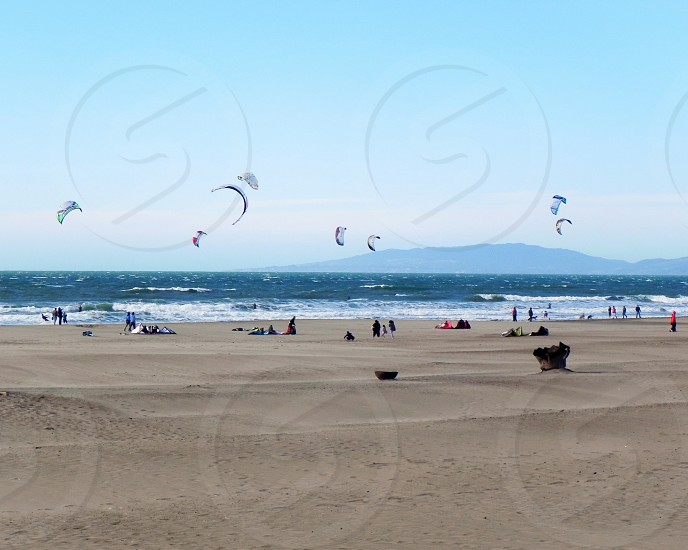 flying kites at the beach photo