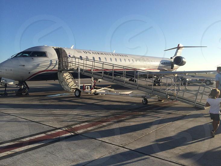 white airplane waiting on board photo