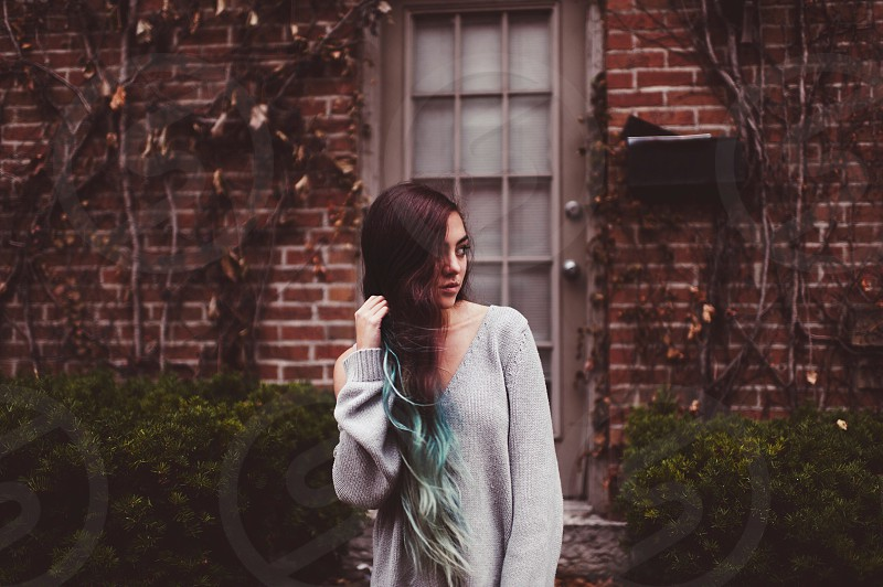 woman standing wearing grey knitted jacket photo